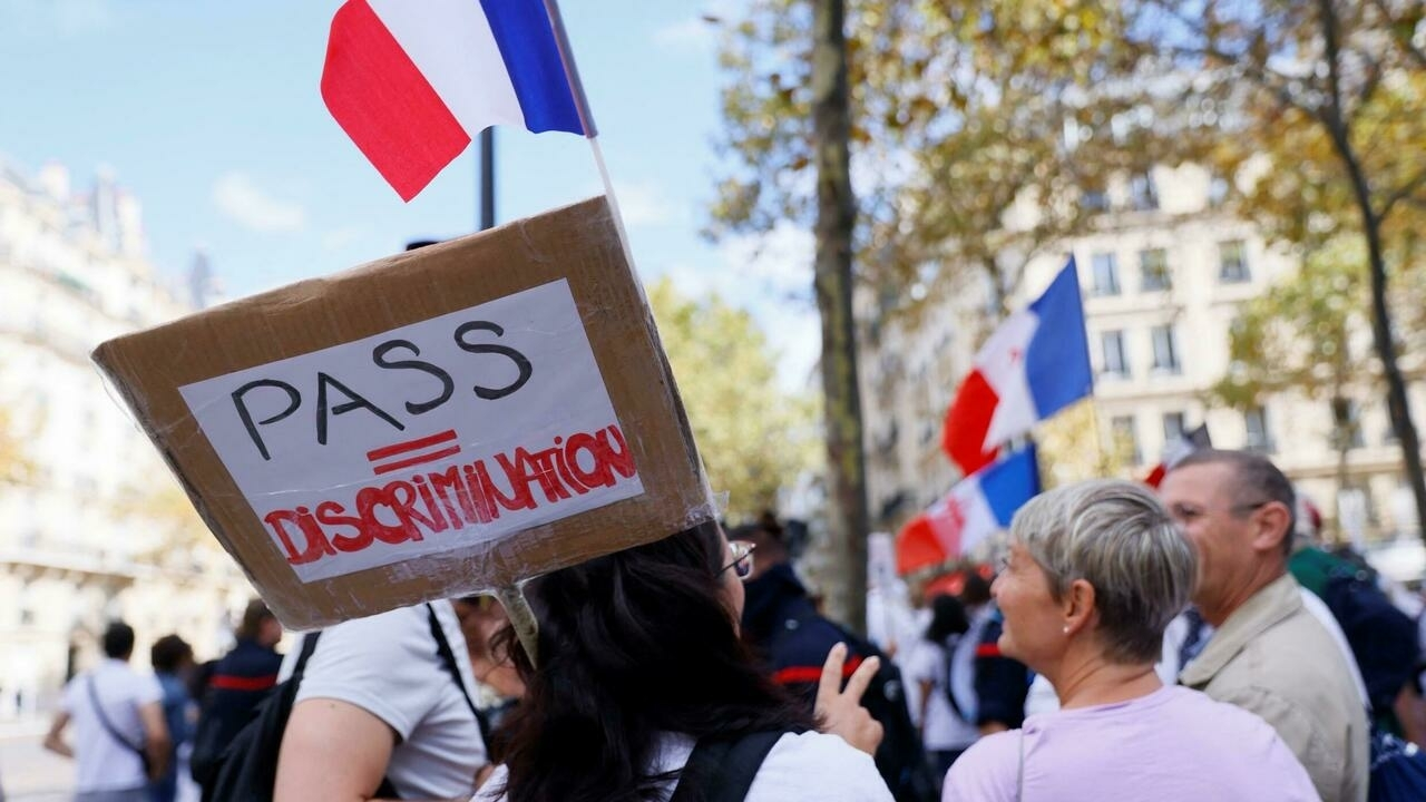 Turnout down slightly for French protests against Covid-19 health pass