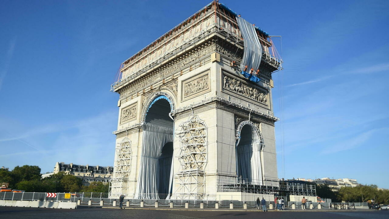 Wrapping of Paris's Arc de Triomphe in fabric begins, a tribute to late artist Christo